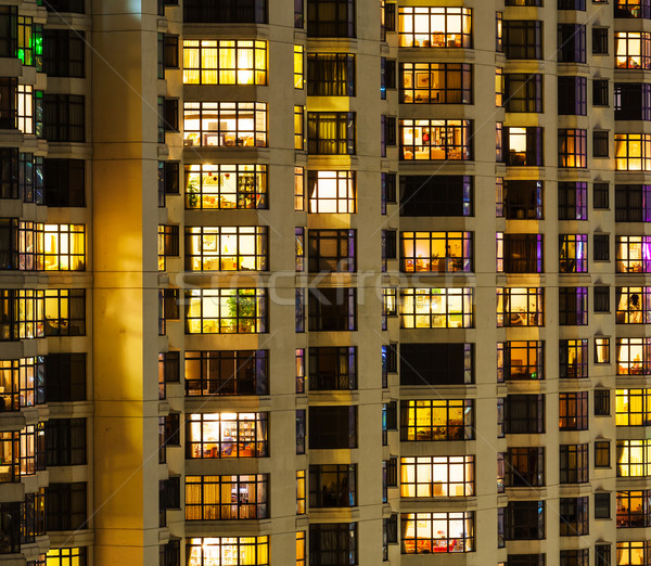 Társasház éjszaka ház épület város ablak Stock fotó © leungchopan