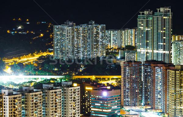 Társasház Hongkong éjszaka ház város fal Stock fotó © leungchopan