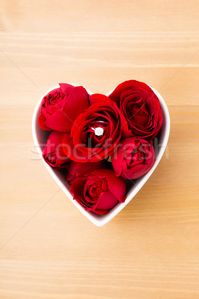 Red rose and diamond ring inside heart shape bowl  Stock photo © leungchopan