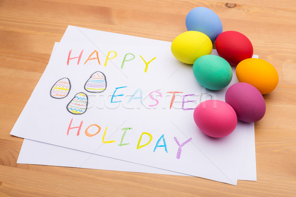 Painted easter egg and kid drawing Stock photo © leungchopan