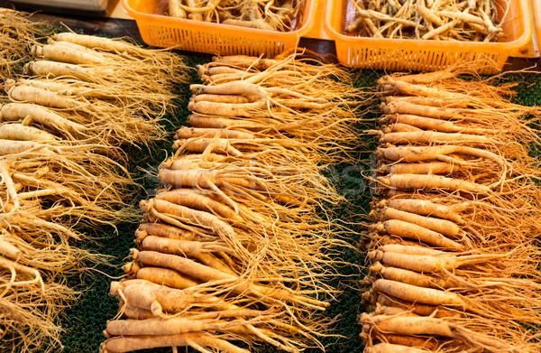 Friss ginzeng bot elad étel piac Stock fotó © leungchopan