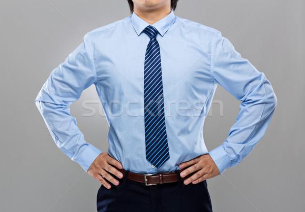 Businessman with hand on waist Stock photo © leungchopan