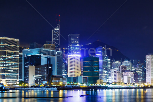 Hong Kong corporate building over the coastline Stock photo © leungchopan