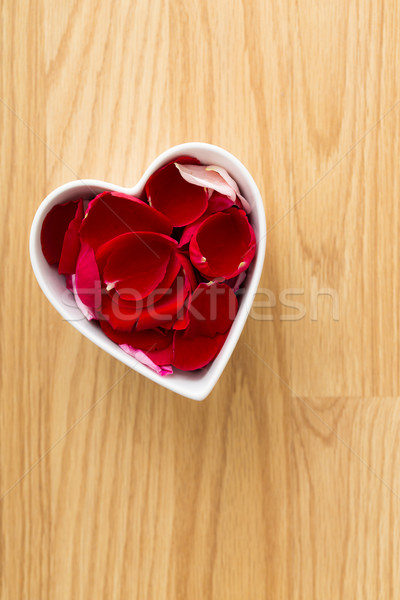 Rose pedal in heart bowl Stock photo © leungchopan