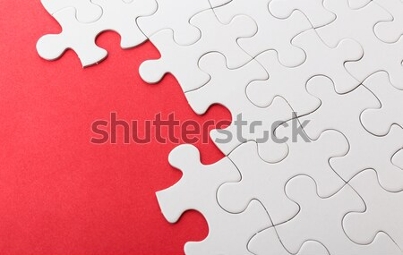 Incomplete puzzle with missing piece over red background Stock photo © leungchopan