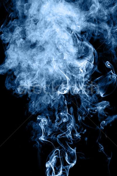 Smoke rising Stock photo © leungchopan