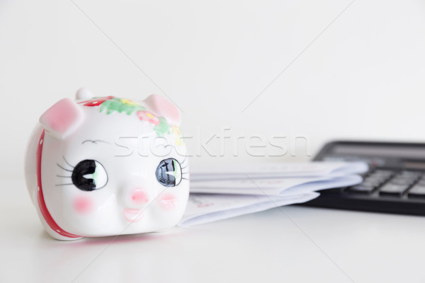 Piggy bank, calculator and statement Stock photo © leungchopan