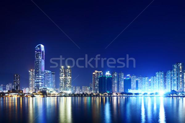 Hongkong éjszaka épület város otthon sziluett Stock fotó © leungchopan