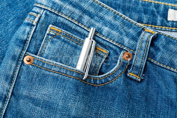 Blue jean and pen Stock photo © leungchopan