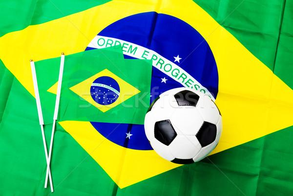 Brazil flag and soccer ball Stock photo © leungchopan