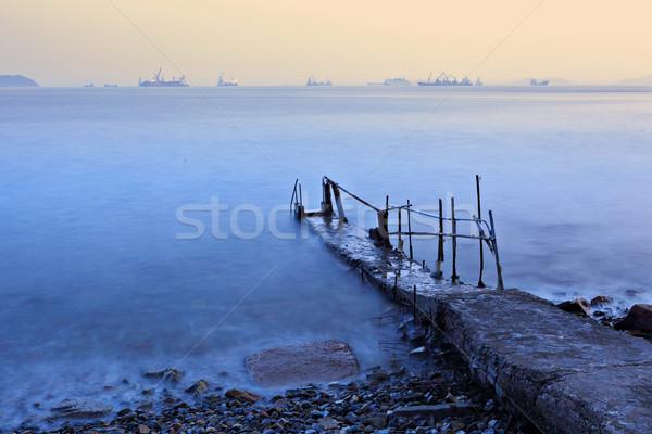 old pier at sunset Stock photo © leungchopan