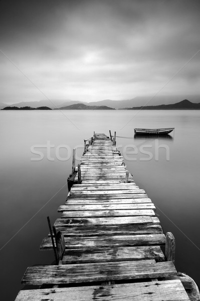 Stock photo: black and white peer with boat