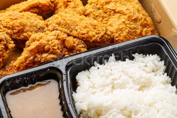 Frango assado arroz caixa frango fresco asa Foto stock © leungchopan