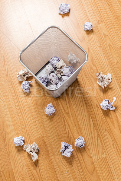 Trash bin and paper ball Stock photo © leungchopan