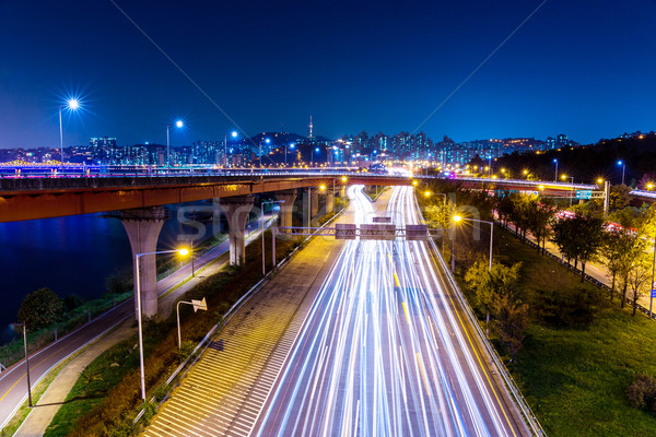 Stock photo: Light trails from vehicles on motorway at night seoul