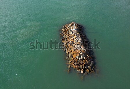 Wave breaker stone with ship Stock photo © leungchopan