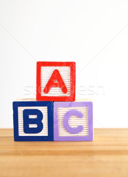 Houten speelgoed brief leren spel leren lezen Stockfoto © leungchopan