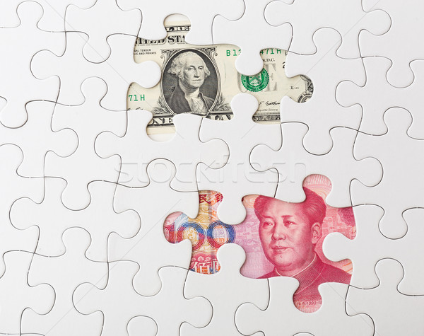 White puzzle with American dollar and chinese yuan Stock photo © leungchopan