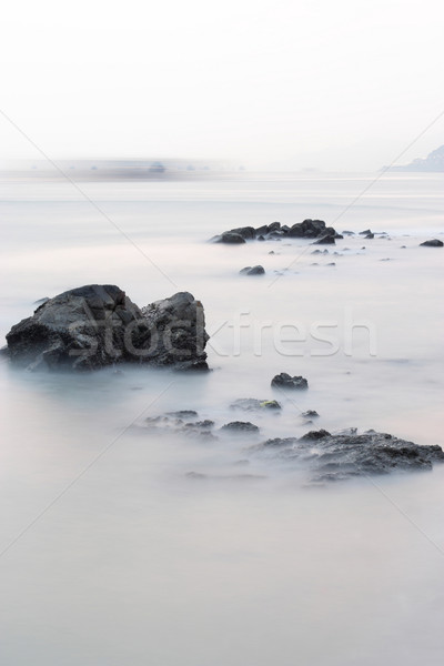 long exposure of rock coast background Stock photo © leungchopan