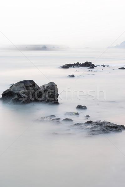 Stok fotoğraf: Uzun · pozlama · kaya · sahil · gün · batımı · manzara · arka · plan