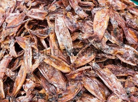 Dried squid on food market Stock photo © leungchopan