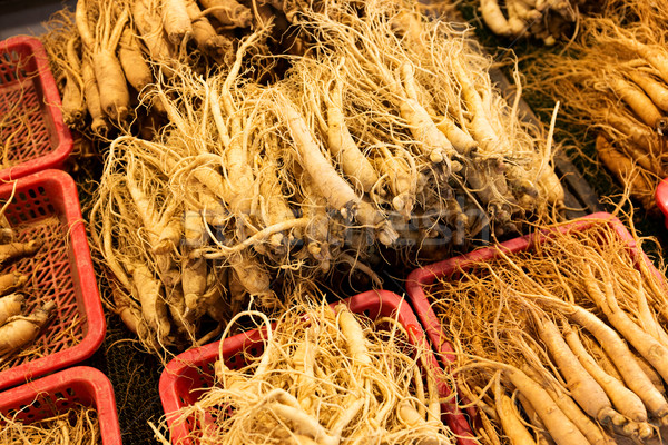 Fresh ginseng for sell in Korean food market Stock photo © leungchopan