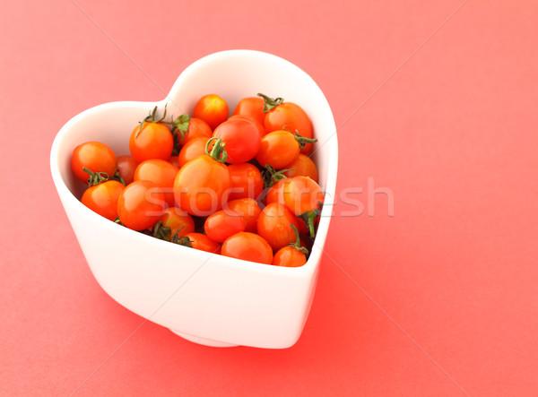 Cherry tomato with love Stock photo © leungchopan