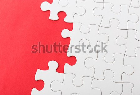 White jigsaw over red background Stock photo © leungchopan