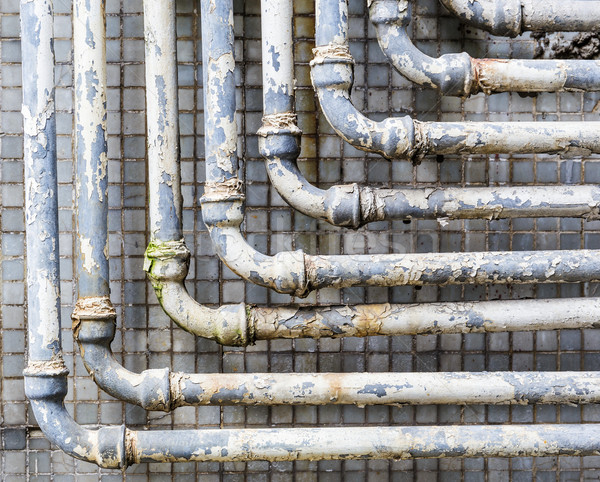 Old pipes on wall Stock photo © leungchopan