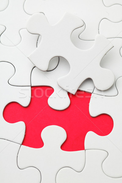 Missing puzzle piece in red color  Stock photo © leungchopan