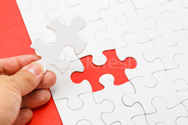 Incomplete puzzle with missing piece on human hand Stock photo © leungchopan