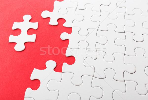 Hiányos puzzle hiányzó darabok csapat piros Stock fotó © leungchopan