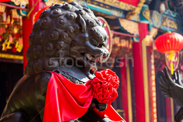 Lion statue in Chinese temple Stock photo © leungchopan