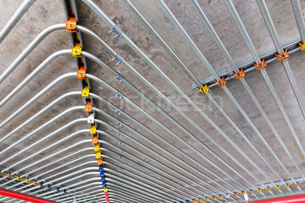 Pipes on ceiling wall Stock photo © leungchopan