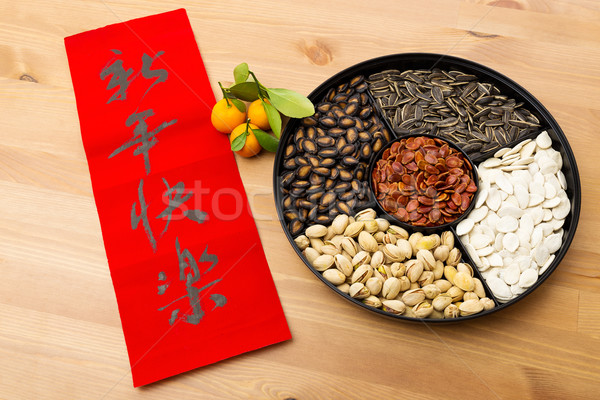 Lunar new year snack tray and chinese calligraphy, meaning is ha Stock photo © leungchopan