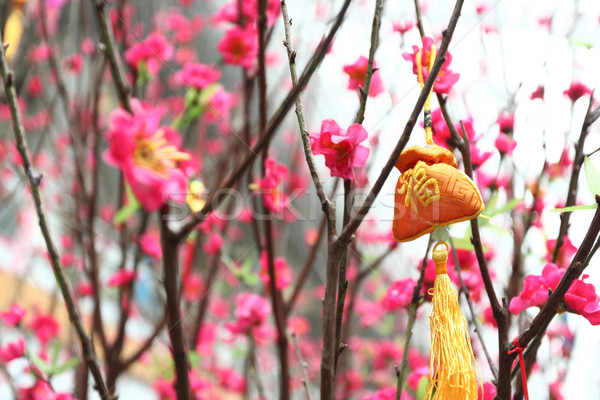Chinese new year decoration--Yellow fortune bag and peach blossom Stock photo © leungchopan
