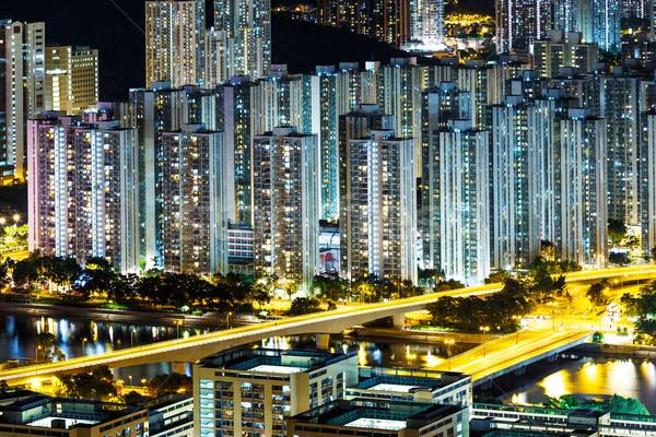 Társasház Hongkong víz város éjszaka sziluett Stock fotó © leungchopan