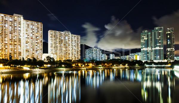 Nyilvános lakásügy Hongkong város sziluett folyó Stock fotó © leungchopan