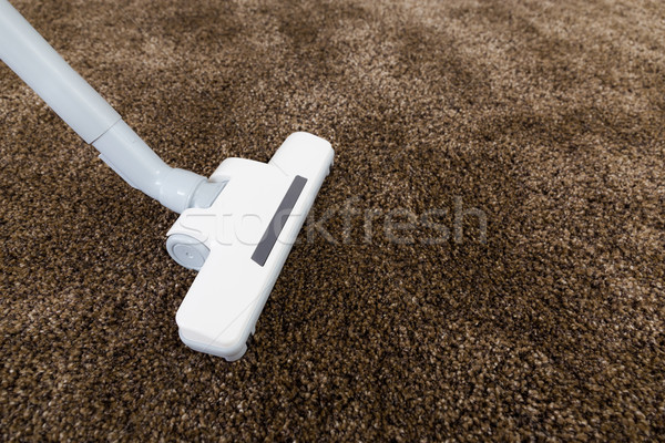 Stock photo: Brown carpet with vacuum cleaner