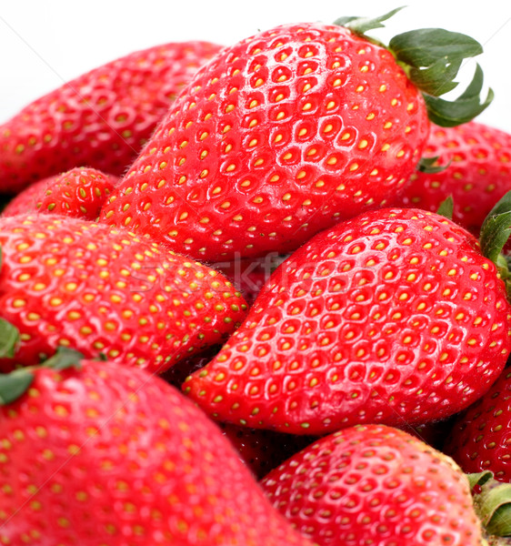 Strawberries isolated over white background Stock photo © leungchopan