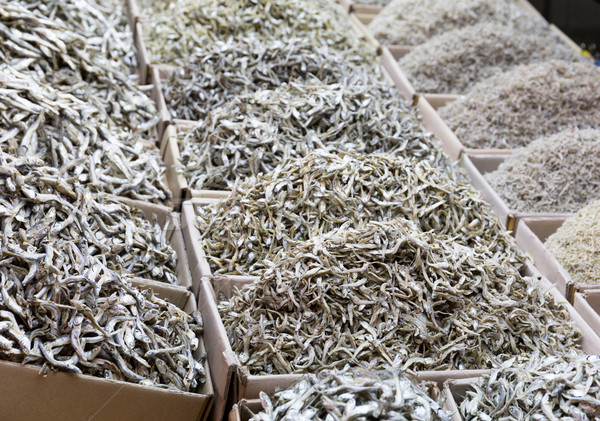 Dried assorted anchovy fish in the market Stock photo © leungchopan