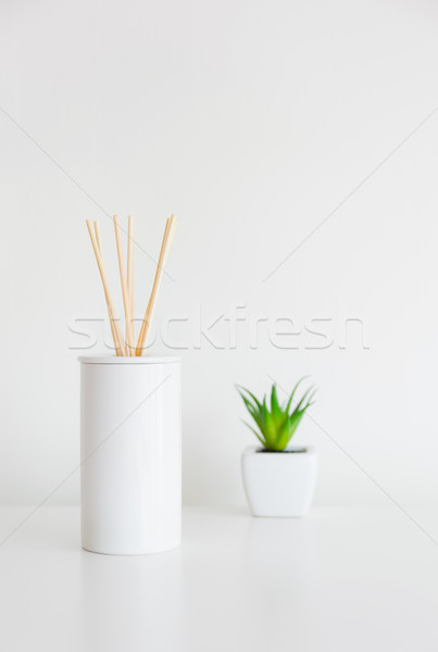House perfume scent diffuser and green plant Stock photo © leungchopan