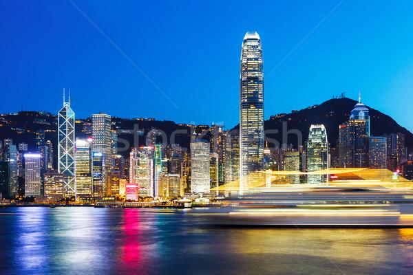 Hong Kong at night from across Victoria Harbor Stock photo © leungchopan