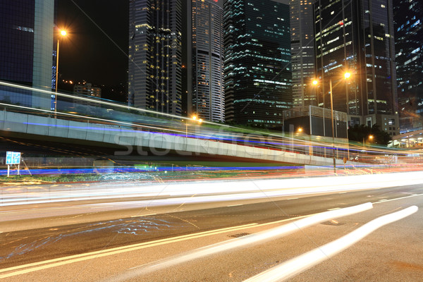 Verkeer zakenwijk nacht auto gebouw abstract Stockfoto © leungchopan