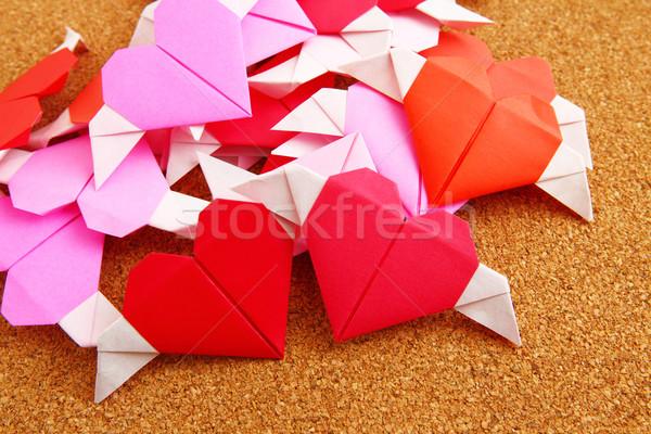 Group of origami colorful heart on corkboard Stock photo © leungchopan