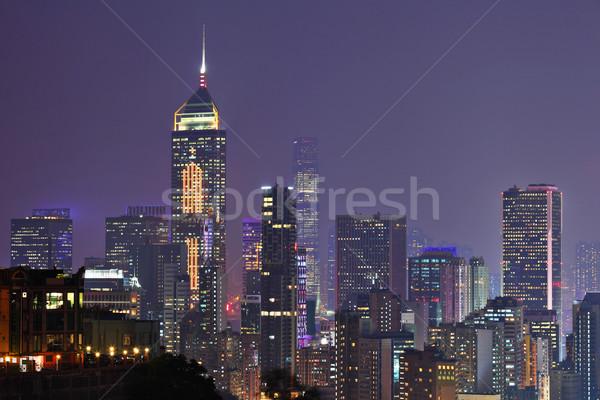 éjszaka kilátás Hongkong égbolt épület tájkép Stock fotó © leungchopan