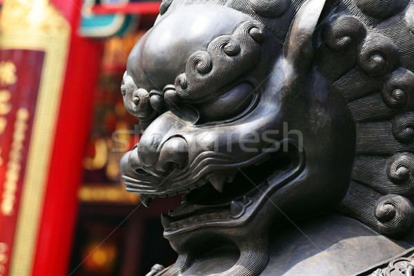Bronze lion in chinese temple Stock photo © leungchopan