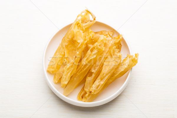 Secar peixe alto bexiga branco prato Foto stock © leungchopan