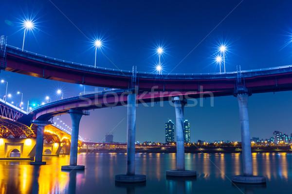 Auto-estrada Seul edifício pôr do sol mar ponte Foto stock © leungchopan