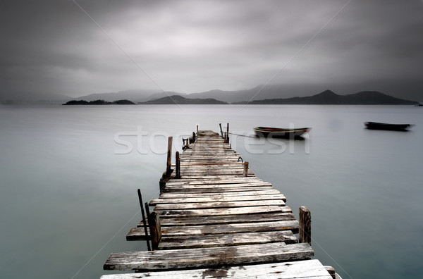 wooden peer with boat Stock photo © leungchopan
